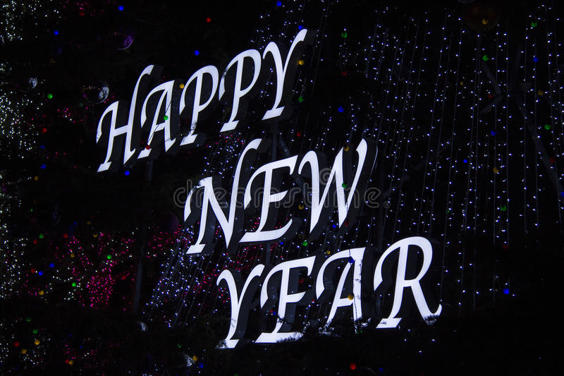 Happy New Year. Light show of Happy New Year on the tree royalty free stock photos