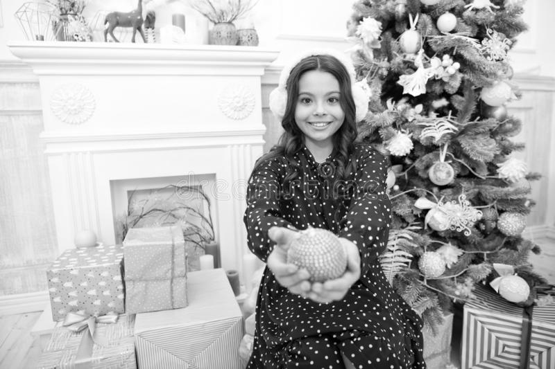 Happy new year. little child girl likes xmas present. Christmas. Kid enjoy the holiday. small happy girl at christmas. Warm earphones. The morning before Xmas stock photography