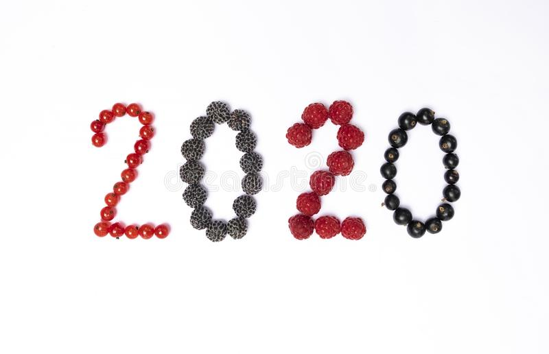 Happy new year 2020 made of berries on the white background. Happy new year 2020 made of berries on the white background stock images