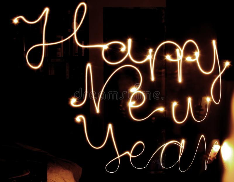 Happy new year. Made of mobile light natural writing with long exposure shot. dark background isolated royalty free stock photography