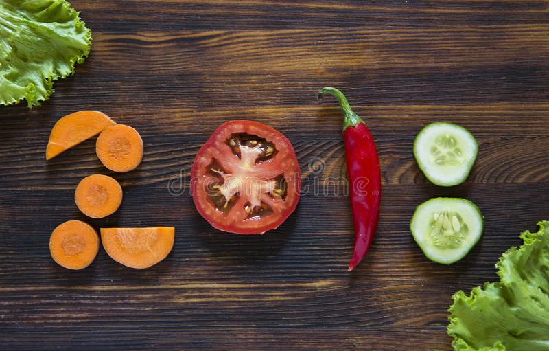 Happy new year 2018 made of vegetables on wooden background. stock image