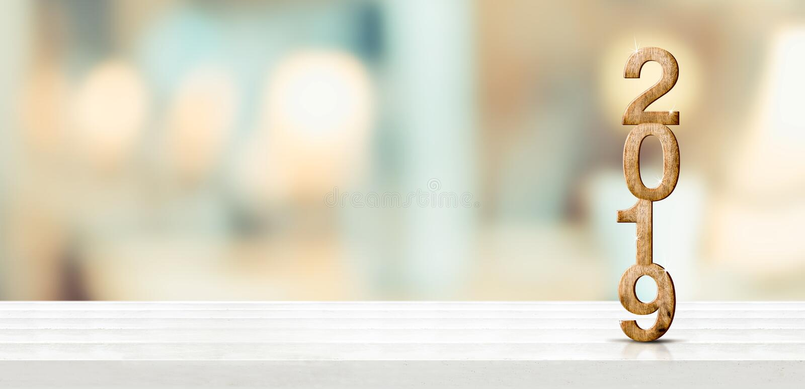 Happy new year 2019 on marble table with pale soft bokeh wall,banner for display or montage of product for holiday promotion and. Advertise for online content royalty free stock photography