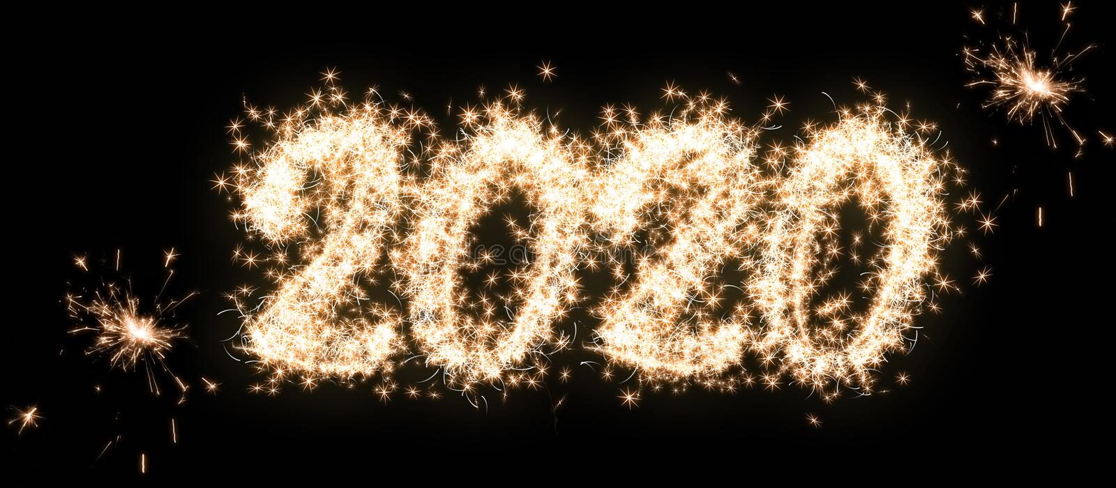 Happy New Year and Merry Christmas 2020 banner. Number 2020 written sparkling sparklers isolated on black background. Overlay royalty free stock photos