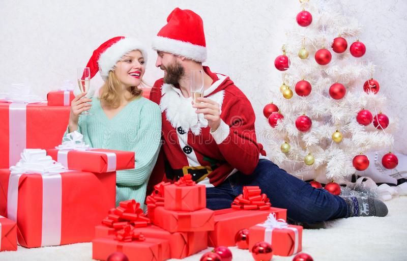 Happy new year and merry christmas. Celebrating christmas together. Loving couple cuddle and drink champagne near royalty free stock photo