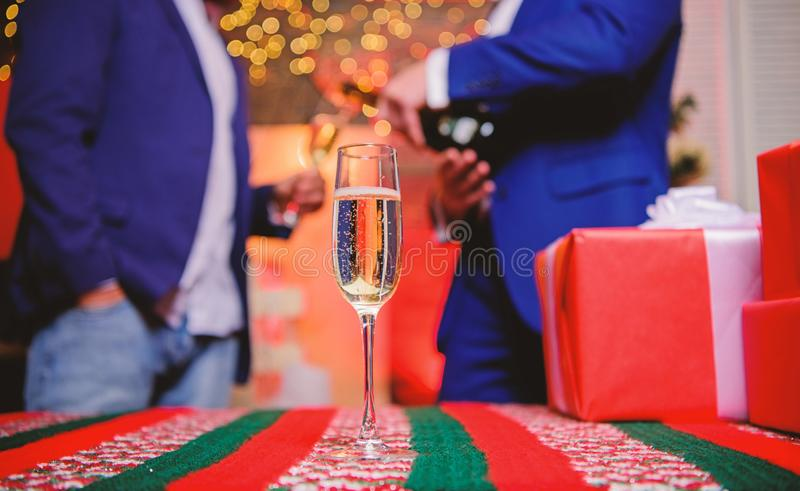 Happy new year and merry christmas. Champagne elegant glass. Glass filled sparkling wine or champagne near gift boxes. New year corporate. Glass of champagne royalty free stock photography