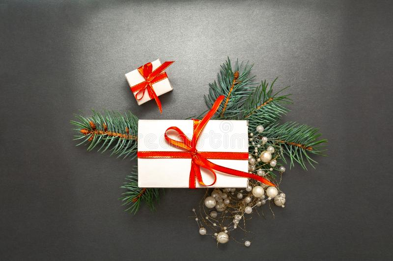 2020 Happy New Year, Merry Christmas decorations flatlay. Gift box, red ribbon, spruce branch top view Boxing Day banner stock photos