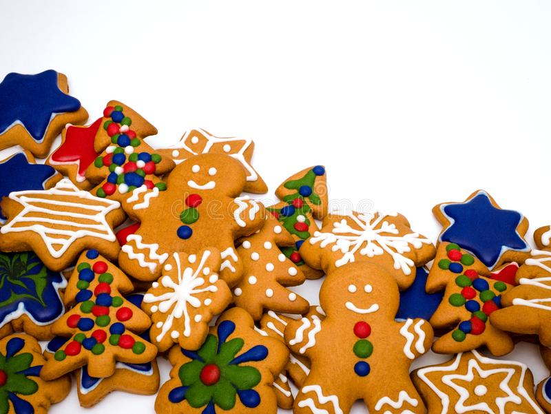 Happy New Year and Merry Christmas gingerbread white background. Christmas baking. Making gingerbread christmas cookies. Christm. Happy New Year and Merry royalty free stock image