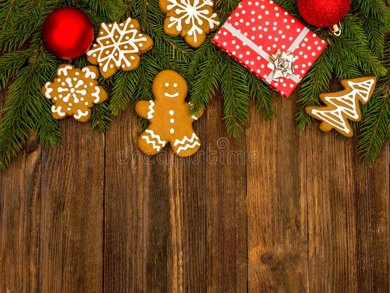Happy New Year and Merry Christmas gingerbread on wood background. Christmas baking. Making gingerbread christmas cookies. Christm. As concept royalty free stock images