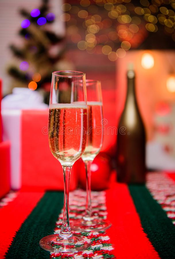 Happy new year and merry christmas. Glass of champagne close up. Champagne couple glasses. Glass filled sparkling wine. Or champagne near gift boxes. Cheers stock image
