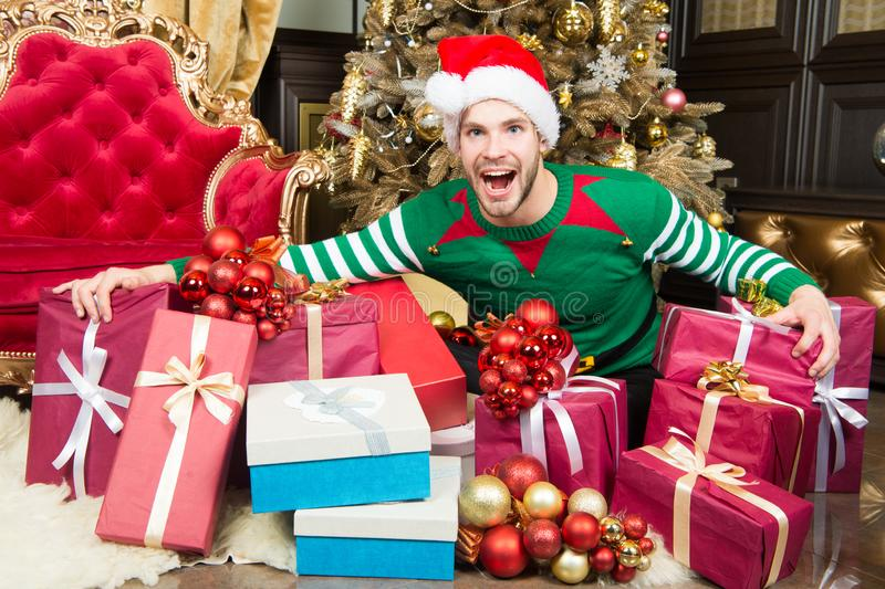 Happy new year and merry christmas. Happy man enjoy new year and christmas party. Man with present boxes by christmas. Tree. Welcome to the party royalty free stock photos