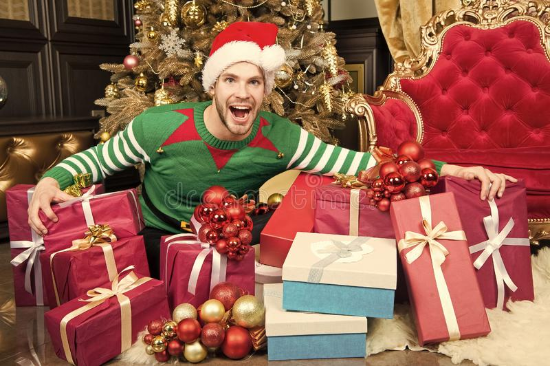 Happy new year and merry christmas. Happy man enjoy new year and christmas party. Man with present boxes by christmas. Tree. Welcome to the party royalty free stock photo