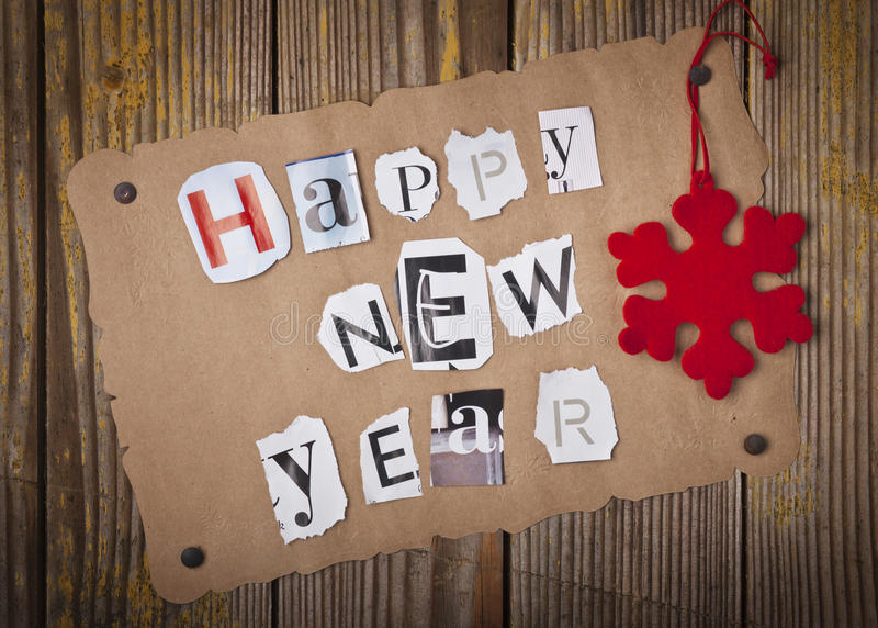 Happy New Year message. On grunge old paper royalty free stock images