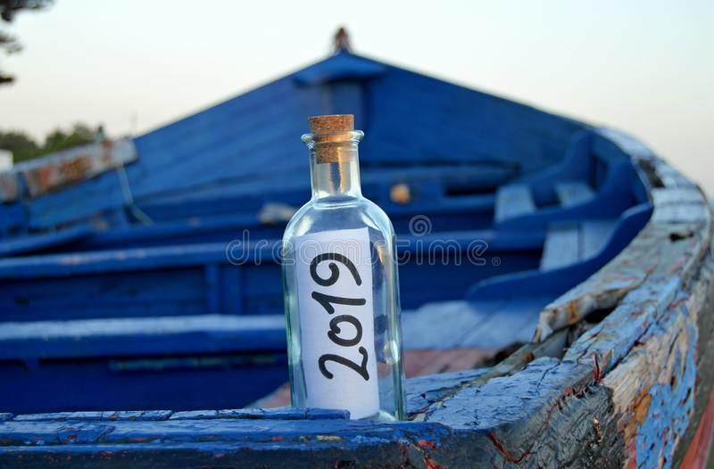 Happy New Year 2019, message in a bottle royalty free stock photo