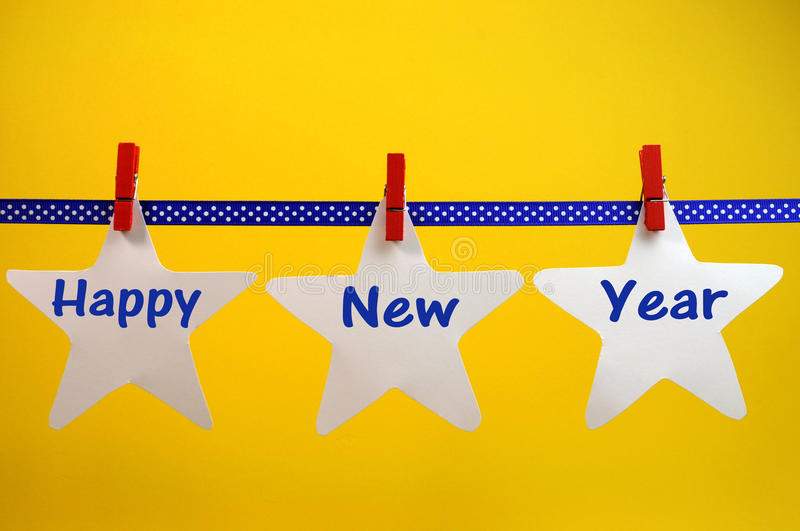 Download Happy New Year Message Greeting Written Across White Stars And Red Pegs On Blue Polka Dot Ribbon Hanging From Pegs On A Line Royalty Free Stock Photos - Image: 32058318