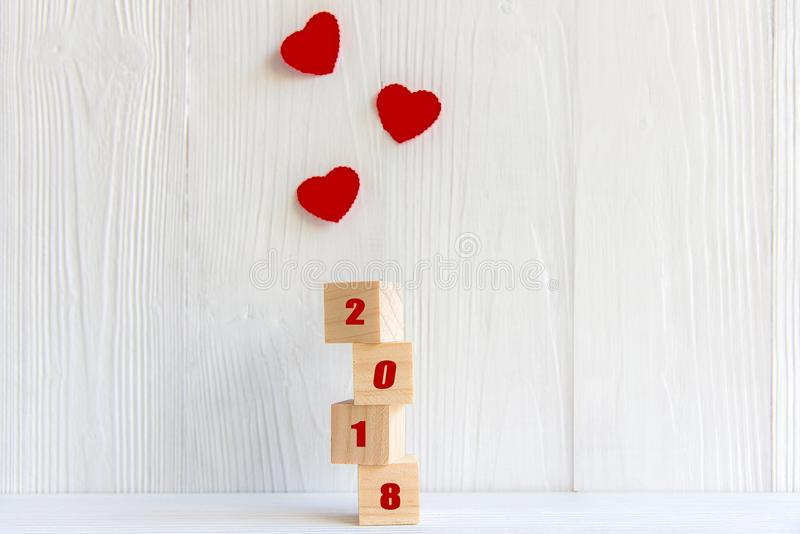 Happy New Year 2018 message written in wooden blocks with red heart, royalty free stock image