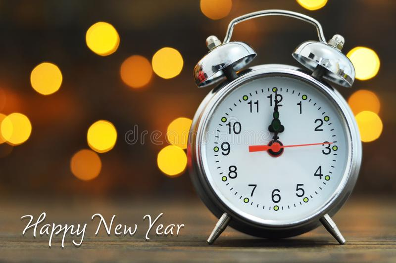 Happy New Year. Midnight clock and blurred lights stock photography