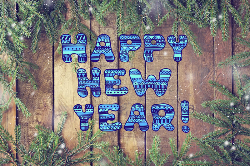 Happy new year! New year or Christmas card. Background of tree branches and wooden planks stock images