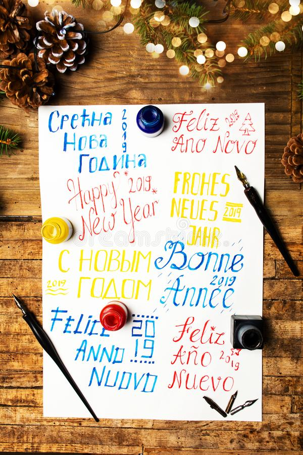 Happy new year note in different languages. Top view royalty free stock photos