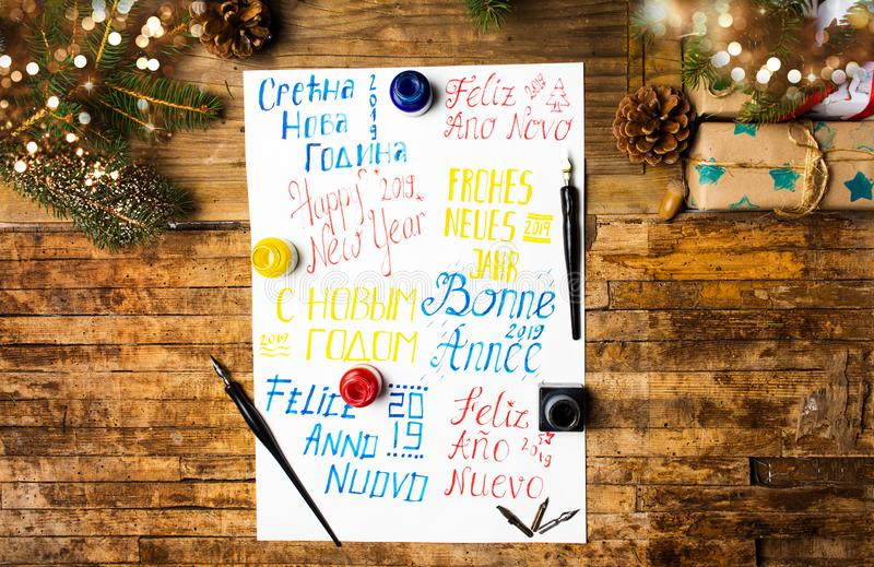 Happy new year note in different languages. Top view stock photos