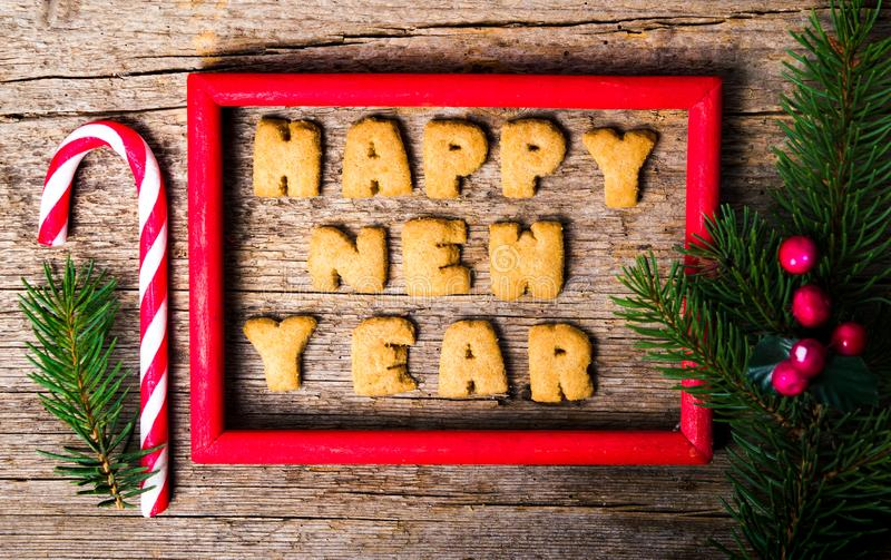 Happy new year note written with cookies. Happy new year note written with cookie letters royalty free stock photos
