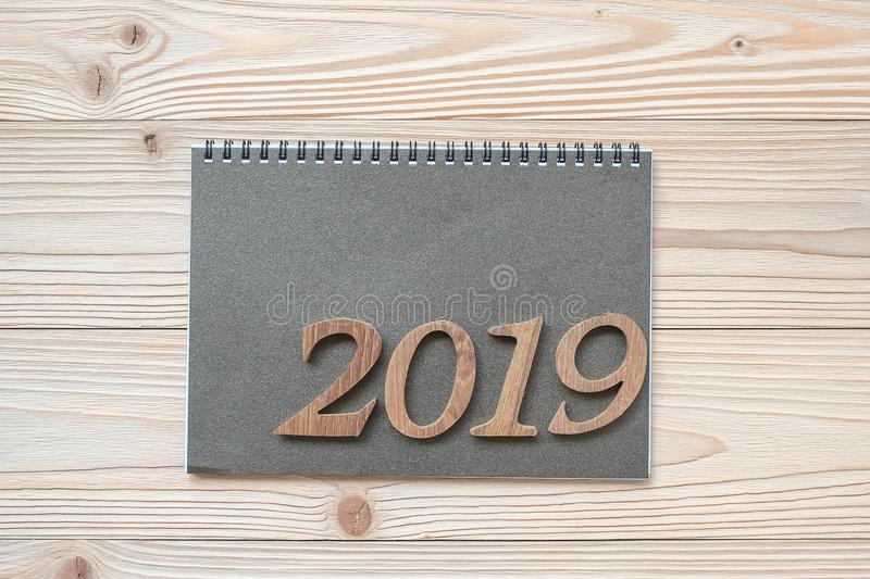 2019 Happy New Year with notebook on wooden table, Top view and copy space. New Start, Goals, Resolution, Solution, Strategy and M royalty free stock images