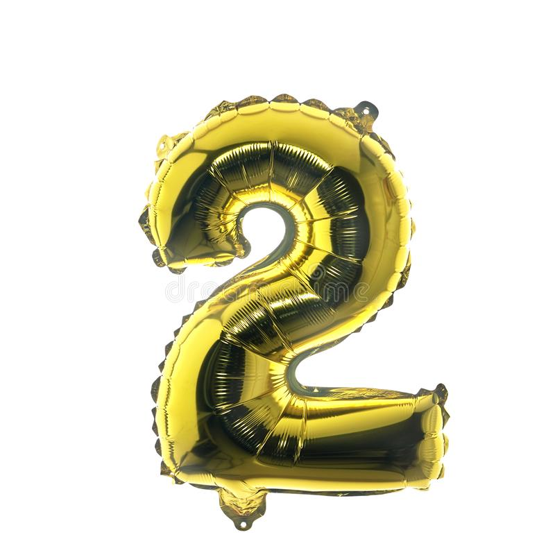 Happy New Year 2020. Number 2 gold balloon. On white background, Flat lay, top view royalty free stock image