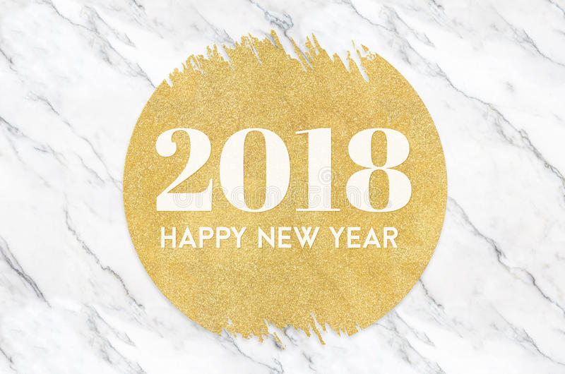 Happy new year 2018 number on gold circle glitter on white marble background,Holiday greeting card.  royalty free stock images