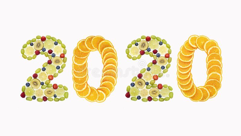 Happy New Year 2020. Number 2020 made of tropical and exotic fruits. Fresh fruits and berries composed in 2020 inscription. Creati stock images