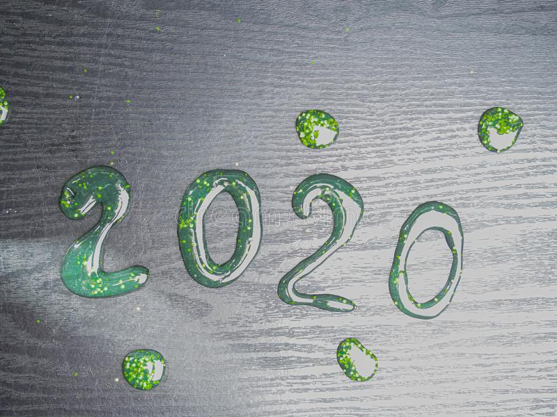 Happy New Year 2020. Number 2020 written sparkling sparklers slime isolated on black background With Copy Space For Text. royalty free stock image