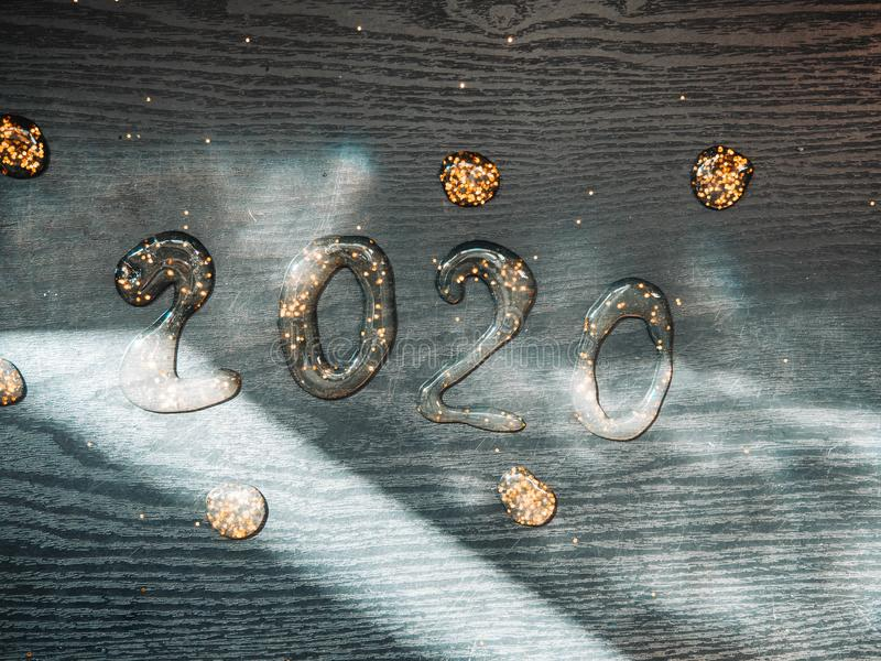 Happy New Year 2020. Number 2020 written sparkling sparklers slime isolated on black background With Copy Space For Text. Happy New Year 2020. Number 2020 stock photo