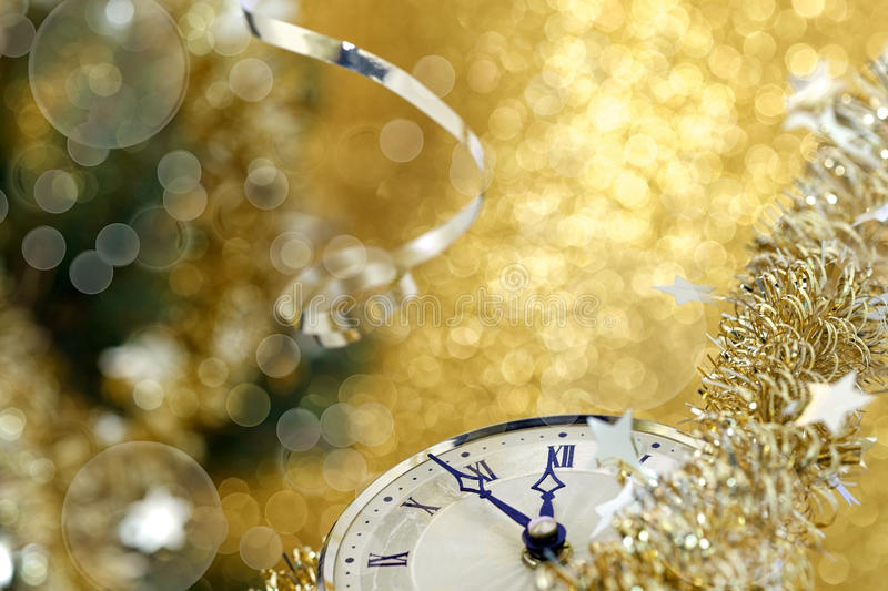 Happy New Year. Old clock on yellow abstract background stock images