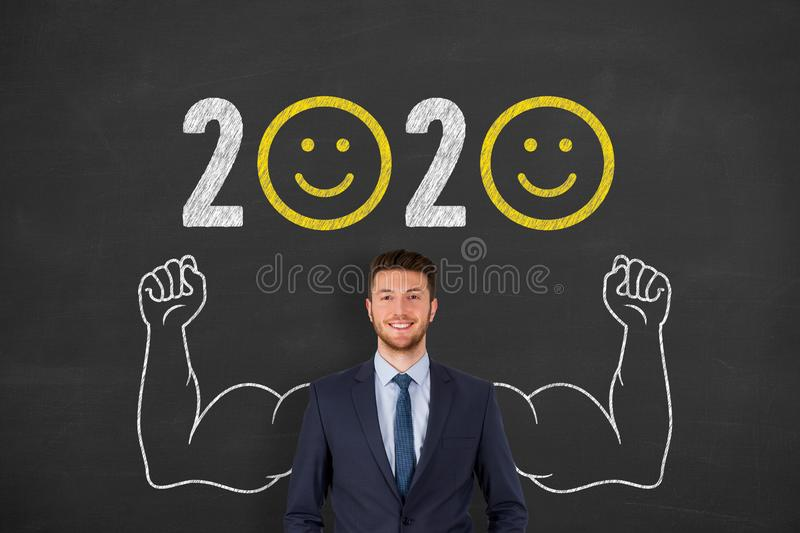 Happy New Year 2020 over Human Head on Chalkboard Background royalty free stock photo