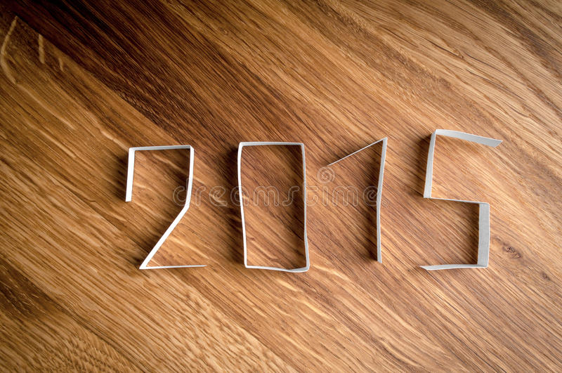 2015 Happy New Year. 2015 Happy New Year paper digits on wood background royalty free stock images