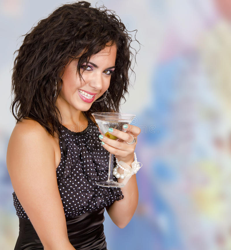 Happy New Year party girl cocktail celebration. Beautiful young brunette woman toasting at happy New Year cocktail celebration royalty free stock photos