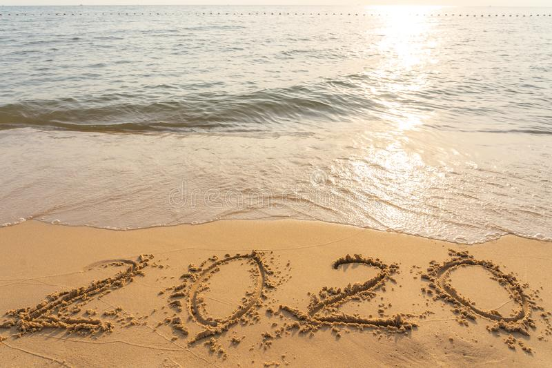 Happy New Year 2020 on the peaceful sand beach. Happy New Year 2020 on the peaceful beach stock photo