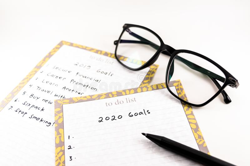 happy new year 2020. planning next goal on blank paper. white background royalty free stock photo