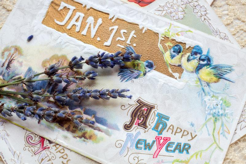 Happy New Year Postcard with Flowers. Closeup of Jan 1st and Happy New Year postcard with flowers royalty free stock photo
