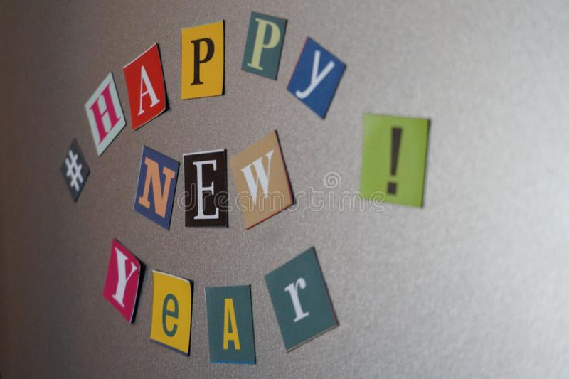 Happy New year. A happy New year poster made with magnetized letters on a refrigerator stock images