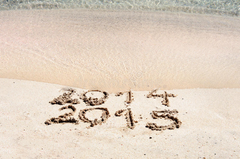 Happy New Year 2015 replace 2014 concept on the sea beach stock photography