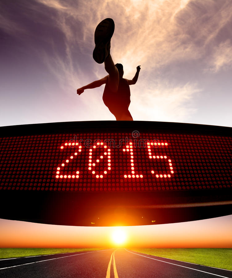 Happy new year 2015.runner jumping and crossing over matrix. Display for celebrating 2015 royalty free stock photos