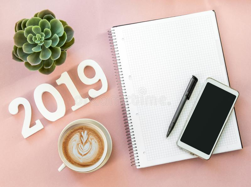 Happy New Year's FLAT LAY 2019 notepad, free space for text. Christmas decorations. Goals for the new year. mockup phone stock images