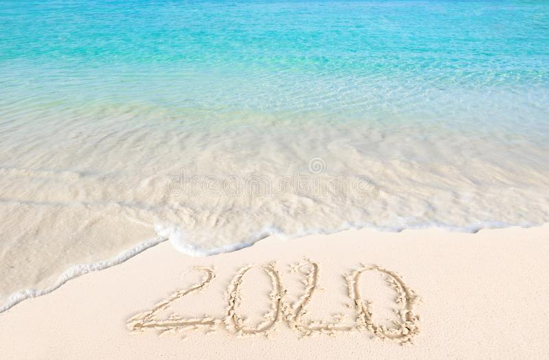 Happy New Year 2020 on the sand and beach stock photography