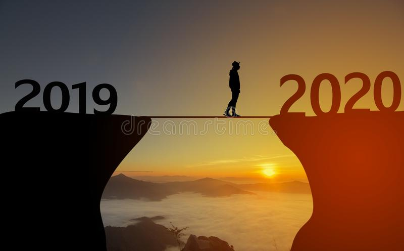 Happy New Year 2020 concept. Happy New Year 2020 silhouette of man walking to 2020 with sunrise for Happy New Year concept stock images