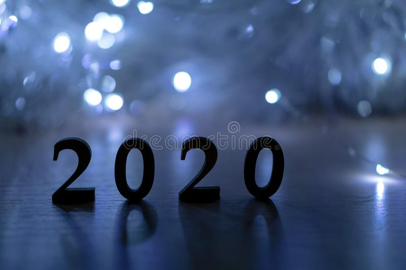 2020 Happy New Year. Silhouette of the number 2020 backlit by a Christmas lights royalty free stock photos
