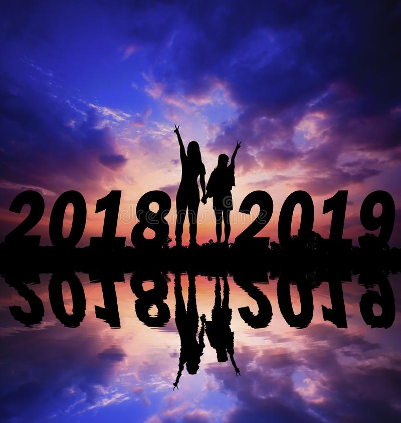 Happy new year Silhouette sunset background. stock photography