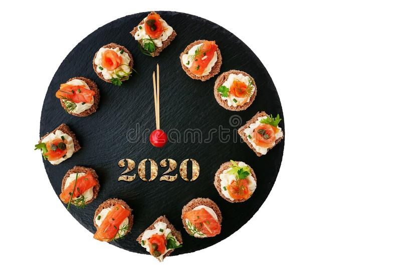 Happy New Year 2020! Smoked salmon canapes on black slate platter stock photography