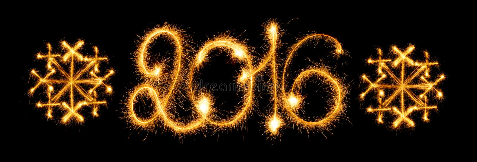 Happy New Year - 2016 with snowflakes made by sparklers on black stock photo