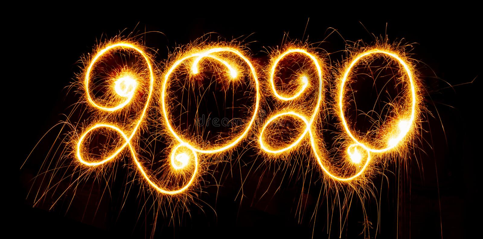 Happy New Year - 2020 with sparklers on black background. Happy New Year 2020 with sparklers on black background stock photography
