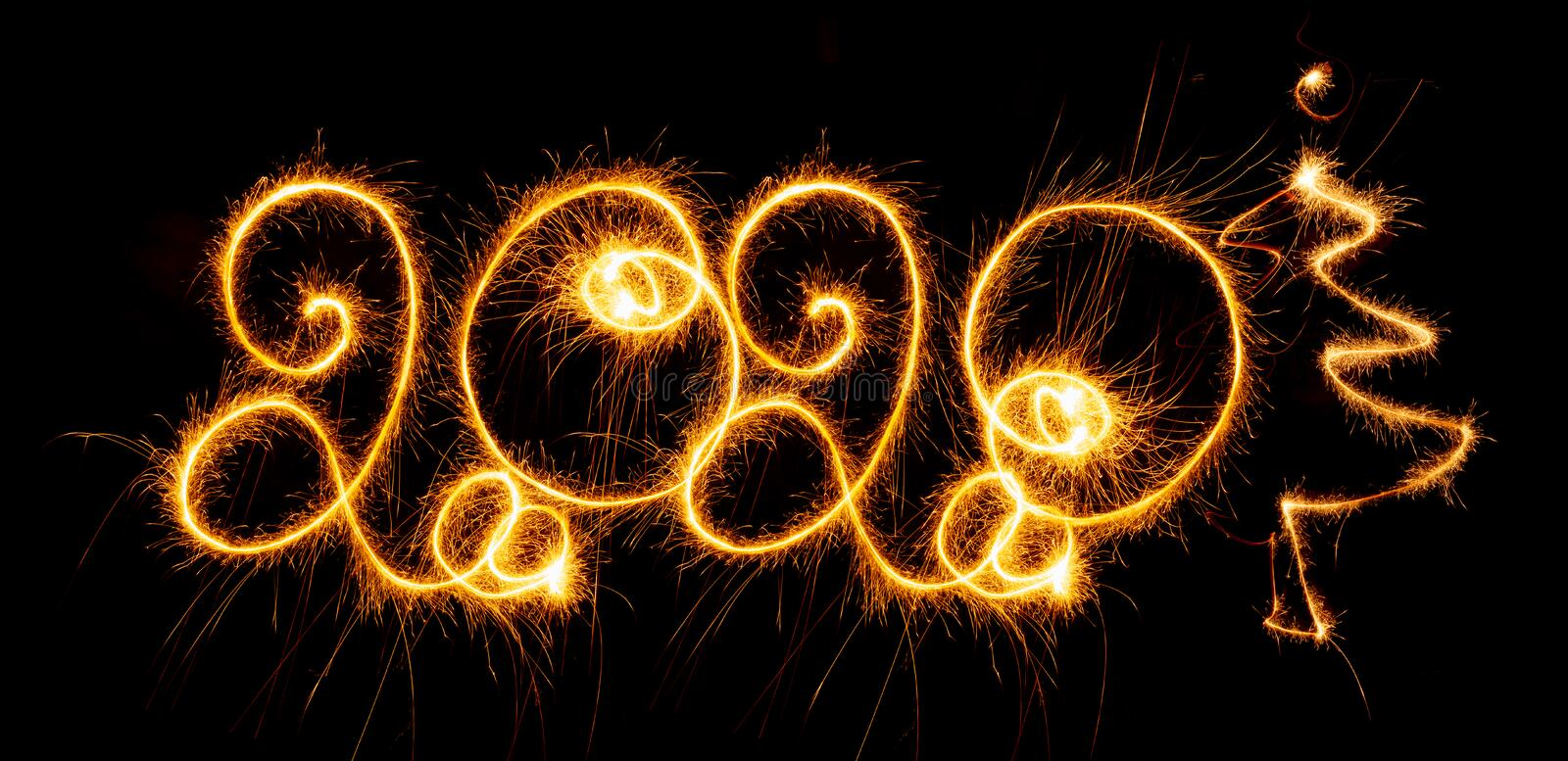 Happy New Year - 2020 with sparklers on black background. Happy New Year 2020 with sparklers on black background stock photos