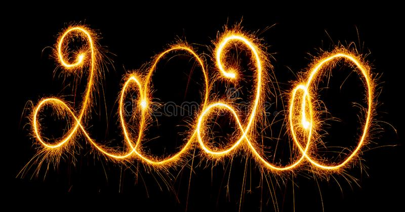 Happy New Year - 2020 with sparklers on black background. Happy New Year 2020 with sparklers on black background royalty free stock photography